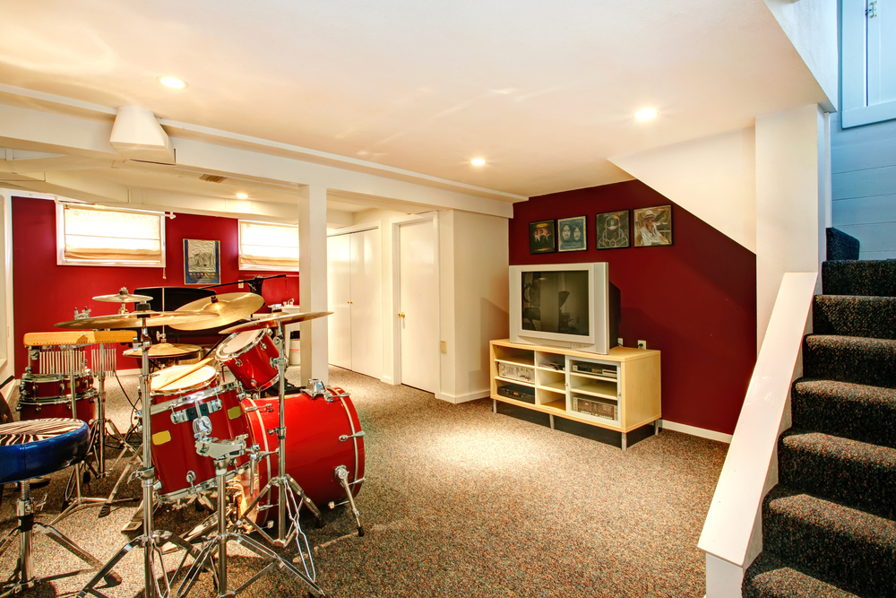 finished basement remodel, with entertainment center and drum kit
