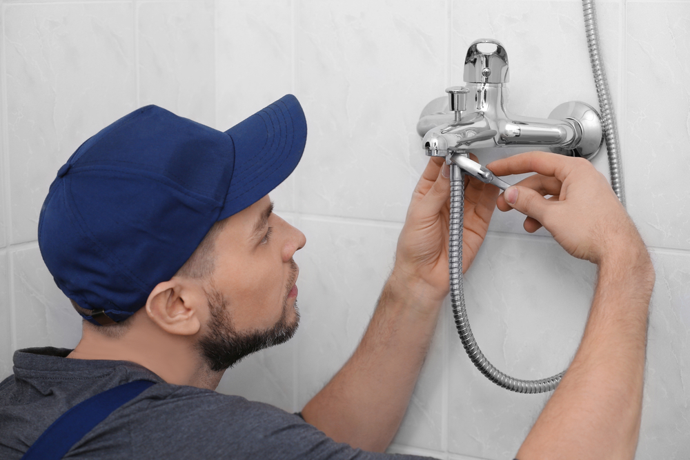 plumber fixing shower faucet